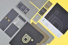 Intra Desarrollos branding stationary corporate identity logo sticker label enveloppe letterhead business card embossed gold foil minimalistic graphic design