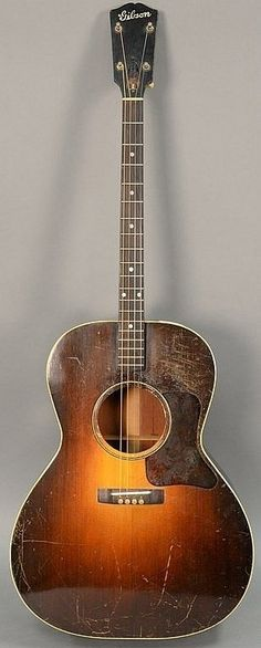 Gibson TG-00 tenor guitar, early 1930's (back has crack). lg. 37 3/4 in. Lot 118