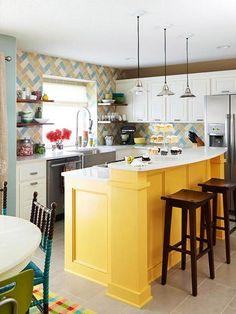 Yellow island and crazy back splash tile, but what really intrigues me are the spindle chairs on the left that appear to be half painted turquoise.
