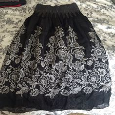 Black floral convertible dress/skirt New listing! Super cute and versatile black floral stretch skirt/dress. Can be worn as a strapless dress or as a cute skirt. One size fits all. Lapis Skirts