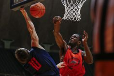 By Daryl Quitalig, The Daily Illini   Illinois' Nnanna Egwu (32) blocks a shot attempt by Mike LaTulip (10) during the Orange and Blue Scrimmage at State Farm Center on Thursday, Oct. 17, 2013.