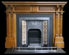 Large antique Victorian oak fireplace surround of architectural form.