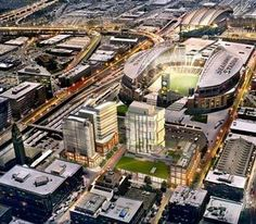 An artist's rendering of Stadium Place, viewed from the north with CenturyLink Field behind it. The proposed second phase is left center, with the hotel tower in front.