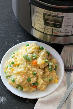 This Instant Pot Cheesy Chicken and Rice will be the best comfort food recipe that you make in your pressure cooker! A one-pot recipe loaded with cheese and mixed vegetables, it will become a family favorite that you make over and over again. Rice Instant Pot Recipe, Instant Pot Dinner Recipes, Creamy Chicken And Rice, Cream Of Chicken Soup, Chicken Rice, Grilled Chicken, Ip Chicken, Creamy Rice, Instant Pot Pressure Cooker