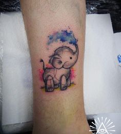 Watercolor baby elephant tattoo by Cynthia Sobraty