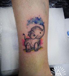 Watercolor baby elephant tattoo by Cynthia Sobraty