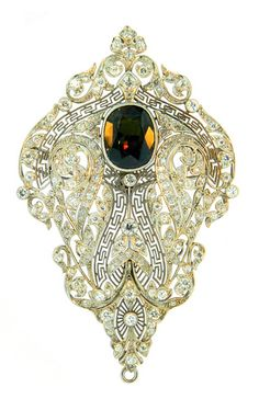 Art Deco Alexandrite, Diamond  Platinum Brooch/pendant,   A beautiful and rare Art Deco, alexandrite and diamond brooch. The alexandrite is estimated to be 8.50ct, with a strong 90% color change from green to purple. It is accompanied by an AGTA and AGL Certificate stating that the alexandrite is Natural with no indications of treatment.
