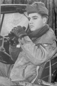 Not looking happy. Elvis later said he HATED being in the army. Couldn't wait to get back home to Graceland !  But being the man he was, he hung in there.