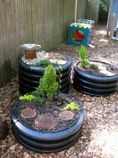 Plant small shrubs/ plants in a tire, and add some tree cookies for imaginative play