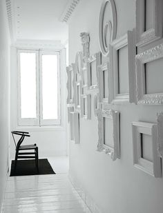 White walls, empty white frames. Love this idea.