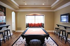 Who really uses their formal dining or formal living room?  Make it a game room/theme party room instead...close to the kitchen for snacks...can always do a switcharoo for dinner or theme parties (check out the pool table/dinner table combo on the board) Use furniture sliding pads to easily move it to the side for a buffet table.