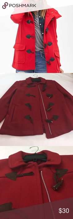 GAP Red duffle coat Red duffle coat with side pockets. She'll 78% wool 22% nylon.  Lining 100% acetate. Used in good condition with run on inside lining. Cover photo for styling purposes only. GAP Jackets & Coats