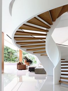 65BTP-HOUSE / ONG&ONG Pte Ltd from archdaily. The company I work for did a similar stair recently, but we made the foot of the outside stringer with a single, gentler, radius.