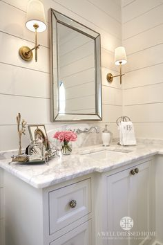 Master bathroom features a white vanity topped with marble under a faucet lining a curved marble backsplash and a beveled beaded mirror, Restoration H… - Marble Bathroom Beaded Mirror, Farmhouse Renovation, Chic Bathrooms, Farmhouse Bathrooms, Master Bathrooms, Dream Bathrooms, Downstairs Bathroom, Tiled Bathrooms, Small Bathrooms