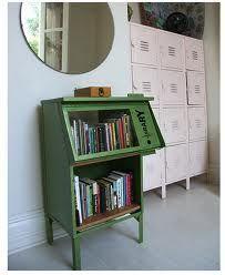 vintage newspaper holder turned bookshelf!  ♥ this idea!!