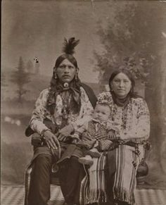 Paul Red Eagle with his wife, Cecelia Red Eagle and their son, Harry Red Eagle - Osage (Beaver Band) - circa 1903