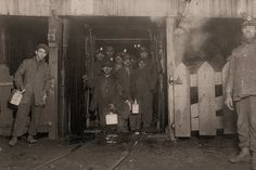 Miners: At the close of day. Waiting for the cage to go up. The cage is entirely open on two sides and not very well protected on the other two, and is usually crowded like this. The small boy in front is Jo Puma. South Pittston, Pennsylvania. Lewis Hine