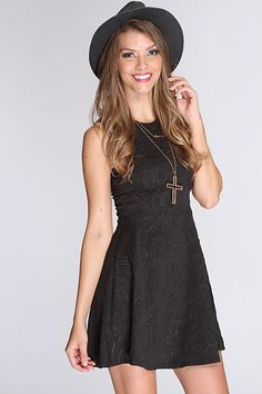 This elegant dress is one to catch attention anywhere you go! Its perfect for a night out with your gals or on a nice date. Perfect for any kind of weather. It will keep you warm at night and nice and cool during the day. Featuring scoop neckline, sleeveless, shoulder cutouts, embossed fabric, fitted and above thee knee length. 94%Polyester 6%Spandex Made in USA