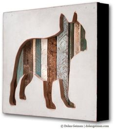 This Dolan Geiman mixed media silhouette featured a cut out dog silhouette in white foreground with reclaimed wood and other rescued materials in the background.