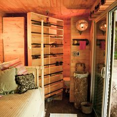 a 20x10 shipping container--uses the container as a guest room, and I also wanted it to be wicked cool. So I fit as many of my wish-book features into it as possible: a revolving door, router marked walls, a sink mounted on a stump, and airplane inspired drop-down shelves for extra space. I got my wish – it's super cool!