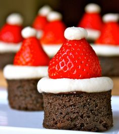 Santa Hat Brownies ~:: Daisy's World ::~ Are you looking for a festive treat? Look no further than these adorable Santa Hat Brownies. They're so much fun and easy to make, and the strawberries, brownies, and mascarpone buttercream make a delicious combination. I'm sure they'll be a hit at your next
