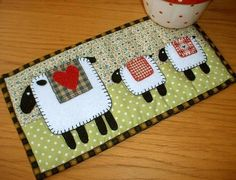 Spring Lambs Mug Rug - pattern found on Craftsy.com