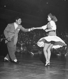 Couple dancing in a jitterbug contest.  Location:	CA, US  Date taken:	September 1946  Photographer:  Peter Stackpole