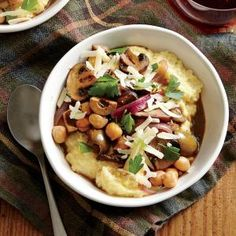 Creamy polenta with mushrooms, chickpeas, and olives.