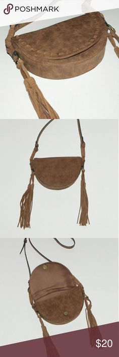 Merona Boho Half Moon Crossbody Handbag W Fringe Merona cross body purse. Adjustable shoulder strap. Inside has a zipped compartment and two misc compartments. One pocket on the outside. Only used twice. In mint condition. Merona Bags Crossbody Bags