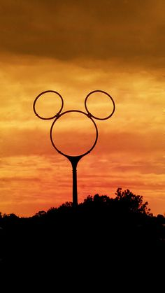 "Mickey electrical tower sunset (Always love seeing the ""Mickey ears"" when we're headed there!)"