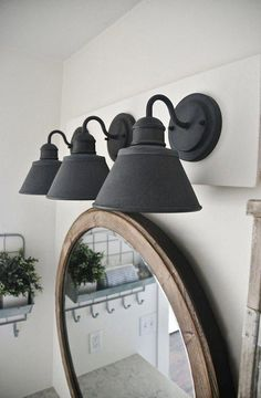 See how to make this super simple farmhouse bathroom vanity light fixture on a b. See how to make Farmhouse Bathroom Light, Modern Farmhouse Lighting, Farmhouse Light Fixtures, Modern Light Fixtures, Light Fixtures Bathroom Vanity, Bathroom Vanity Decor, Bathroom Ideas, Bathroom Inspo, Bathroom Makeovers