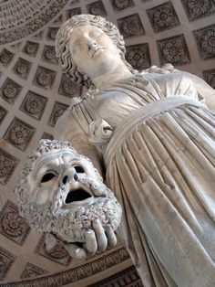Melpomene: Opposite from Thalia, Muse Melpomene was the protector of Tragedy; she invented tragedy, rhetoric speech and Melos. She was depicted holding a tragedy mask and usually bearing a bat.