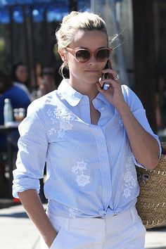 Reese Witherspoon stuck to a classic all-American pairing of a wispy knot and crisp striped shirt. - shopping shirts, all white button down shirt, short sleeve men's button down shirts *ad Reese Witherspoon Style, Preppy Style, My Style, Gamine Style, Chloe Sevigny, Shirt Refashion, Classic Outfits, Classic Clothes, Comfortable Fashion