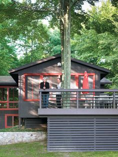 Built around the twin trunks of a maple tree, the Campbells' outdoor deck provides tranquil views of the lake and a chance for the family to spot roaming wildlife while enjoying their morning coffee. During warmer months, the wide space creates an ideal s