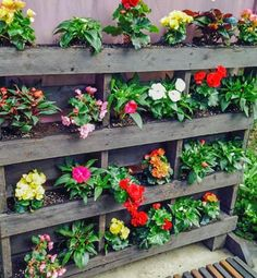 Enhance your outdoor entertainment space with this Vertical Pallet Garden! Give your back yard a pop of color with one of our favorite DIY garden ideas yet. There are so many different things you can do with wood pallets for your outdoor space. Garden Ideas To Make, Diy Garden, Herb Garden, Garden Projects, Vegetable Garden, Garden Landscaping, Garden Ideas For Pallets, Gravel Garden, Garden Trees
