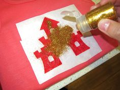 Tutorial on how to make glitter tees using E-6000 and freezer paper