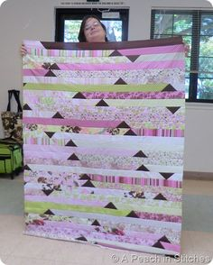 jelly roll race quilt with flying geese added