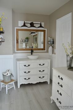 Vintage Farmhouse Bathroom.  Mirror had gold trim, now painted with pure white chalk paint.  Tile floors, lights had back board added, bath towels hang on chippy board with hooks...see other pic's.