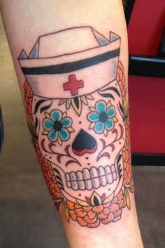 Fun nurse sugar skull on a great client. By Aaron Goodrich at New Rose Tattoo in Portland Oregon.
