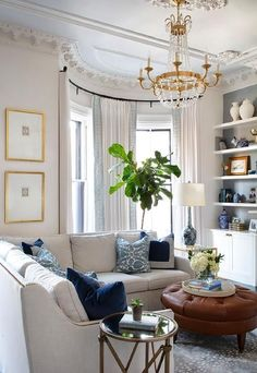 We are loving this one, y'all! The chandelier really makes the space feel elegantk, while the couch and coffee table give it a cozy feel! We love how these two elements complement each other in this space! Via DecorPad #interiordesign #livingroom #livingroomdesign #couch #neutral #neutralaccents #frame #goldframes #builtins #lamp #coffeetable #browncoffeetable #accents #decor #livingroomdecor #pillows #bluepillows #plant #drapery #bluedrapes #endtables #brass #brassaccents #shelving Formal Living Rooms, Home Living Room, Living Room Designs, Living Room Decor, Living Spaces, Small Living, Apartment Living, Modern Living, White Rooms