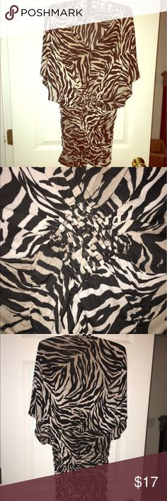 Tiger print dolman sleeve knit dress size small Very cool tiger print dress from NYC boutique. audrey hill Dresses Mini