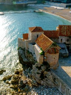 Water and architecture based on stone and brick. Budva Old Town, Montenegro