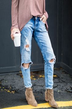 Distressed denim + suede booties.