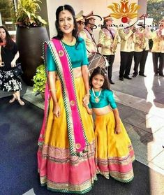 Mom and kids girls dress buy for contact on WhatsApp +919214873512 ,door delivery available, fabric silk , prices 5500/Rs , shipping extra . Yellow and froze Mother Daugther Lehenga sets Mom Daughter Matching Dresses, Mom And Baby Dresses, Dresses Kids Girl, Matching Family Outfits, Kids Outfits, Indian Designer Outfits, Indian Outfits, Indian Clothes, Mother Daughter Fashion