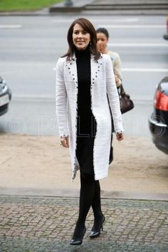 In a Chanel coat