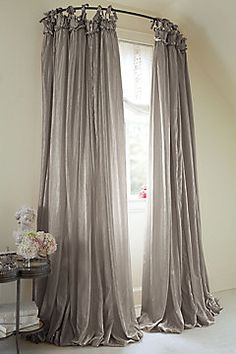 I love the look of this rounded shower rod and curtains that are extra long.