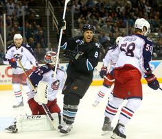 San Jose Sharks forward Joe Pavelski is all smiles after a first period goal (Oct. 23, 2014).