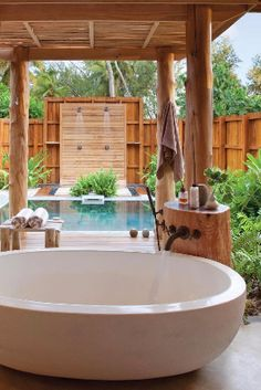 Giant tubs are big enough for two. Or cool off under alfresco his-and-hers showers. Desroches Island Seychelles - Jetsetter