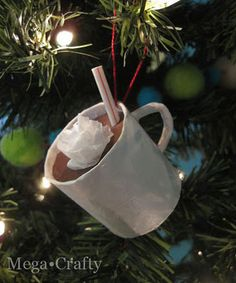 Hot cocoa ornament made from a paper towel tube and other items found around the home...virtually free!