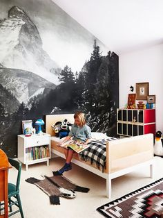 Rustic inspired kids' room with a larger-than-life wall covering depicting the mountains